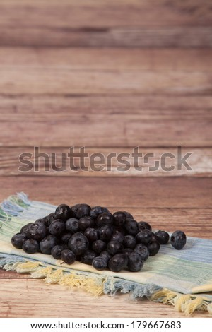 Fresh Blueberries In a Rustic Setting - stock photo