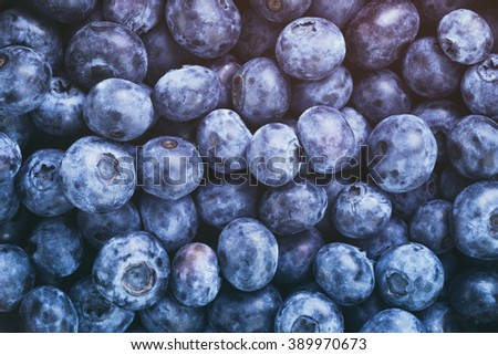 fresh blueberries top view background, vintage toned - stock photo