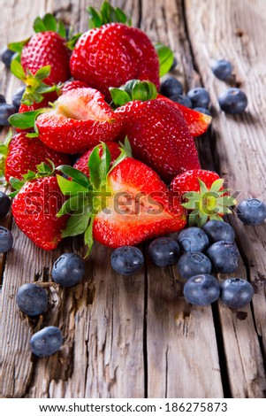 Fresh blueberry and strawberry on wooden table. Berry - wood. Garden fruits. Organic - stock photo
