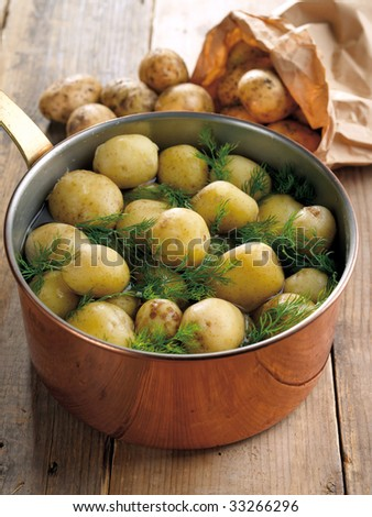 Fresh boiled potatoes with dill - stock photo