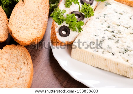 Fresh bread and blue cheese from above - stock photo
