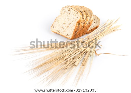 fresh bread and wheat on white background - stock photo