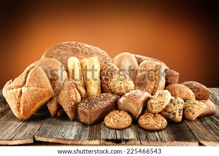 fresh bread of brown and brown wall space  - stock photo