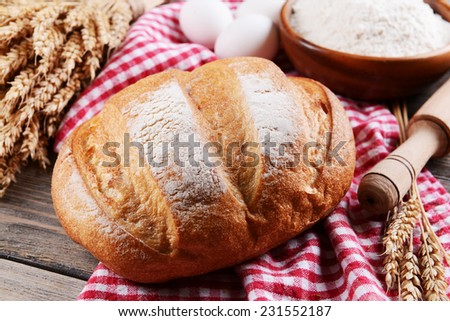 Fresh bread on table close-up - stock photo