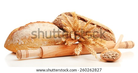 Fresh bread with wheat and sunflower seeds in wooden spoon isolated on white - stock photo