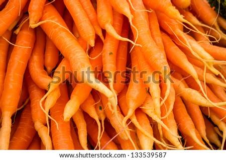 Fresh bright orange carrots at the farmer's market - stock photo