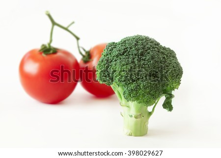 fresh broccoli and tomatoes isolated on white background - stock photo