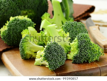 Fresh broccoli on a wooden board - stock photo