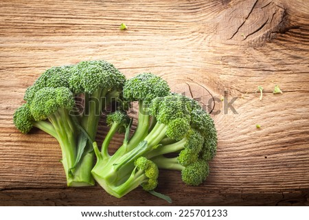 Fresh broccoli on the wooden table - stock photo