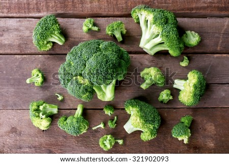 Fresh broccoli on wooden background - stock photo