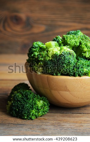 Fresh broccoli on wooden background, close-up. Selective focus - stock photo