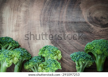 Fresh broccoli on wooden board for background - stock photo