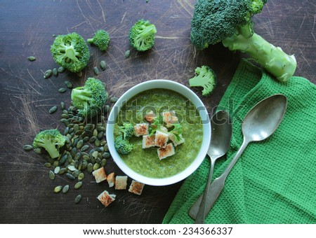Fresh broccoli soup in a bowl with croutons - stock photo