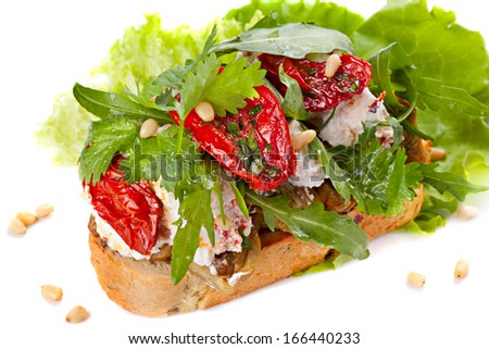 Fresh bruschetta with cheese and sun-dried tomatoes - stock photo