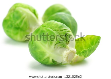 Fresh brussels sprouts isolated on white background. - stock photo