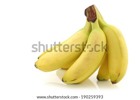 fresh bunch of mini bananas on a white background - stock photo