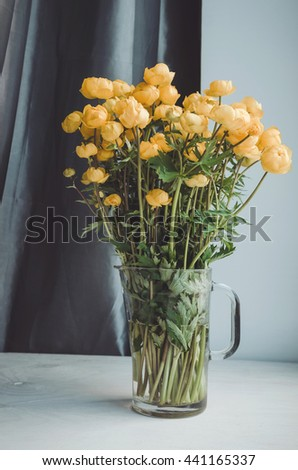 Fresh bunch of yellow summer flowers in glass vase on a white windowsill background. Cozy home rustic style decor, still life concept. Village ,  gardening. Tonal correction filter effect - stock photo