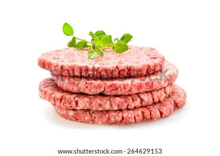 Fresh Burger patties raw on a white underground - stock photo