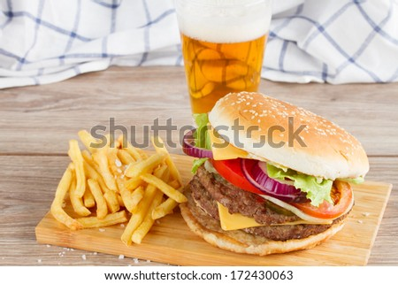 Fresh  burger with french fries and beer - stock photo