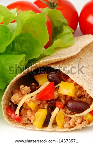 Fresh burrito with meat and beans - stock photo