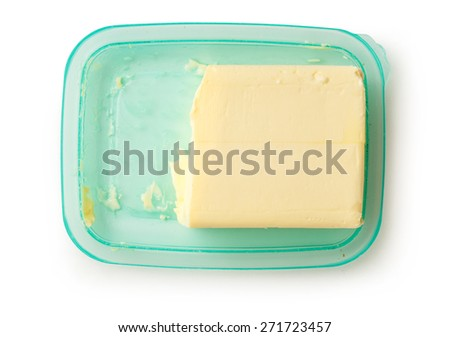 Fresh butter on the open green butterdish - stock photo