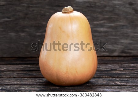 Fresh butternut squash on wooden table. - stock photo
