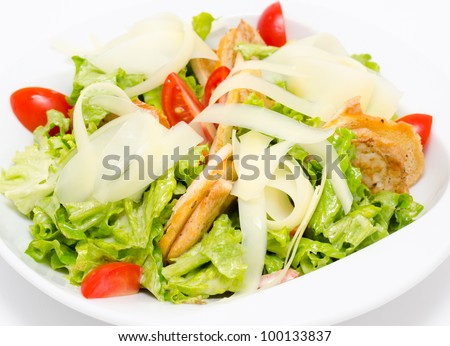 fresh Caesar salad with ham and tomatoes - stock photo