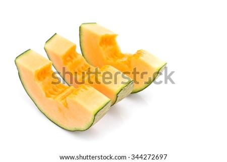 fresh cantaloupe melon slices on white background - stock photo