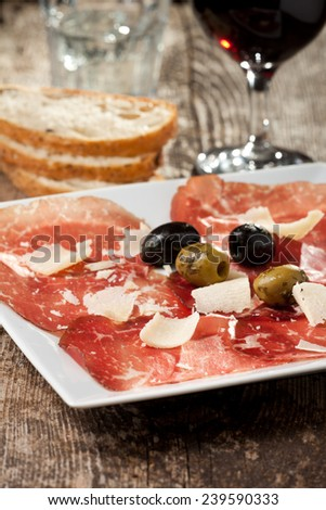 fresh carpaccio on a plate  - stock photo