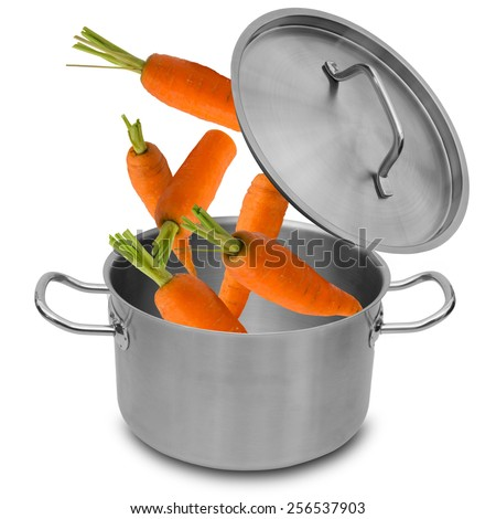 Fresh carrot falling into stainless steel pot isolated on white background. - stock photo