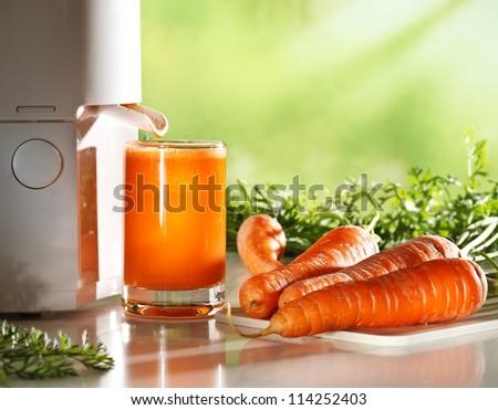 Fresh carrot juice - stock photo