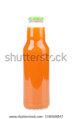 Fresh carrot juice in a bottle. Isolated on a white background. - stock photo
