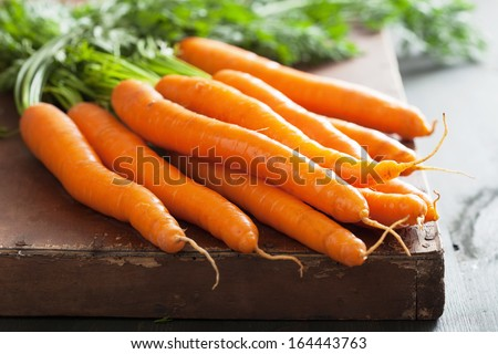 fresh carrot over wooden background  - stock photo