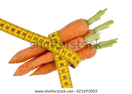 fresh carrots with tape measure - stock photo