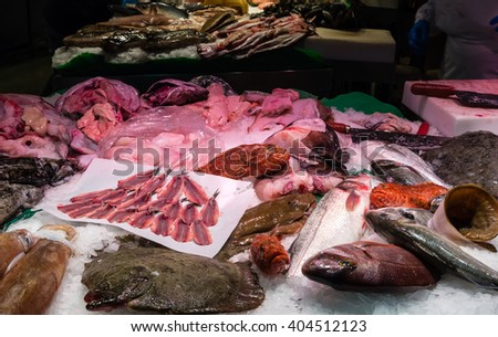 fresh caught fish on display at a market - stock photo