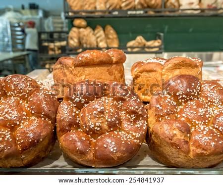 Fresh Challah bread at the bakery display for Shabbat. - stock photo