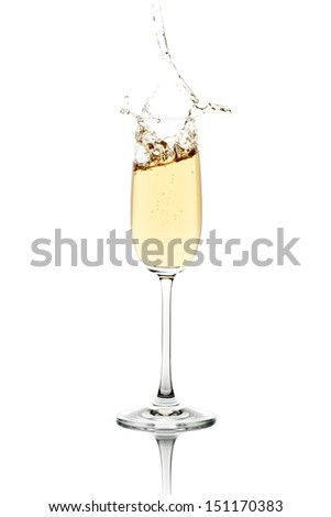 Fresh champagne, splashing out the crystal flute. - stock photo