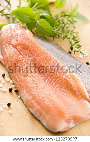 fresh char with herbs on the wooden plate - stock photo