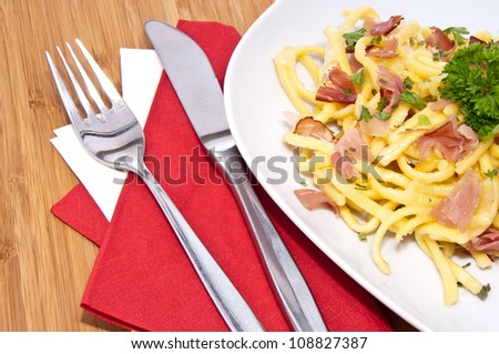 Fresh Cheese Spaetzle decorated with Parsley on a plate - stock photo