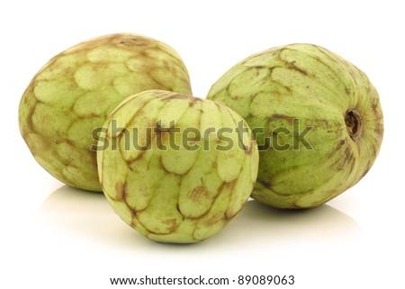 fresh cherimoya fruits (Annona cherimola) on a white background - stock photo