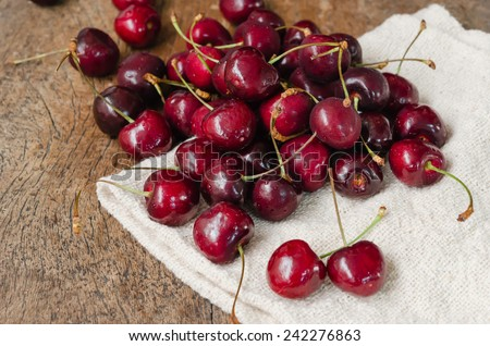 fresh cherries on wooden table  background - stock photo
