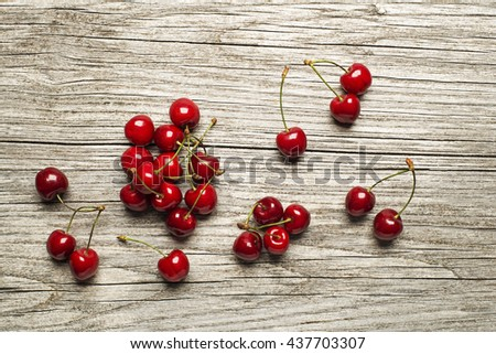 Fresh cherries on wooden table close up. - stock photo