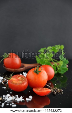 Fresh cherry tomato with salt and black pepper on background - stock photo