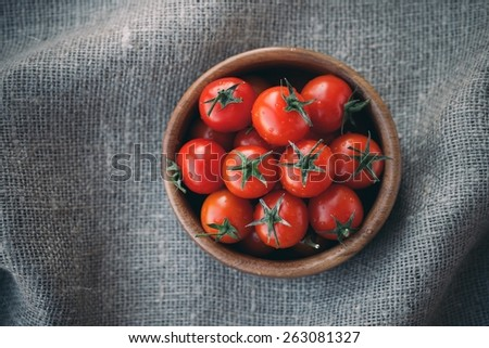 Fresh Cherry Tomatoes In A Wooden Bowl Top View - stock photo