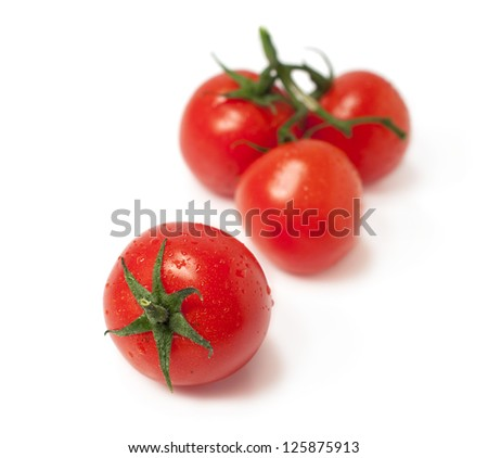 Fresh cherry tomatoes isolated on white background - stock photo
