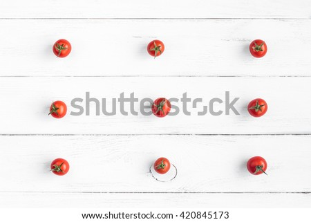 Fresh cherry tomatoes on wooden white background. Creative tomatoes flat lay, top view - stock photo