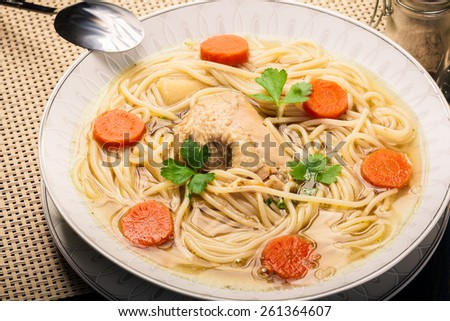 Fresh chicken broth with noodles and carrot - stock photo