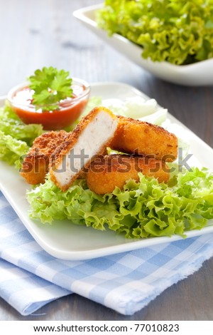 fresh chicken nuggets with ketchup and salad - stock photo