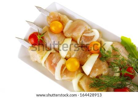 fresh chicken shish kebab on plate with vegetables - stock photo