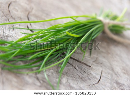 Fresh chive on wooden table - stock photo